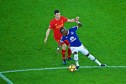 LIVERPOOL, ENGLAND - Monday, December 19, 2016: Liverpool's James Milner and Everton's Enner Valencia during the FA Premier League match, the 227th Merseyside Derby, at Goodison Park. (Pic by Gavin Trafford/Propaganda)