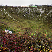 The Lochnagar Crater is the largest manmade crater created in WWI. The mine was laid by the 179th Tunneling Company Royal Engineers and it was exploded two minutes before 7:30 (the zero hour for the british offensive) on the morning of July 1st 1916.  At the time this was the largest man made explosion ever made and there are reports that it was heard in London. In 1978 the area was purchased by Richard Dunning who decided to reserve the place and make a memorial.