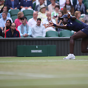 LONDON, ENGLAND - JULY 14: A ball girl in action on Center Court during the Wimbledon Lawn Tennis Championships at the All England Lawn Tennis and Croquet Club at Wimbledon on July 14, 2017 in London, England. (Photo by Tim Clayton/Corbis via Getty Images)