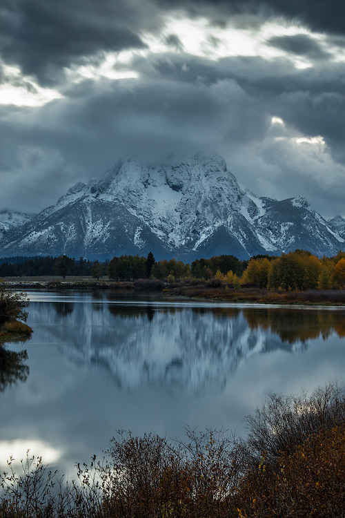 Mt. Moran partially reflected in the Snake River in Grand Teton National Park at Oxbow Bend on a gloomy Fall Day.