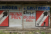 Political slogans painted on the side of a house, Quincemil adjacent to the Interoceanic Highway