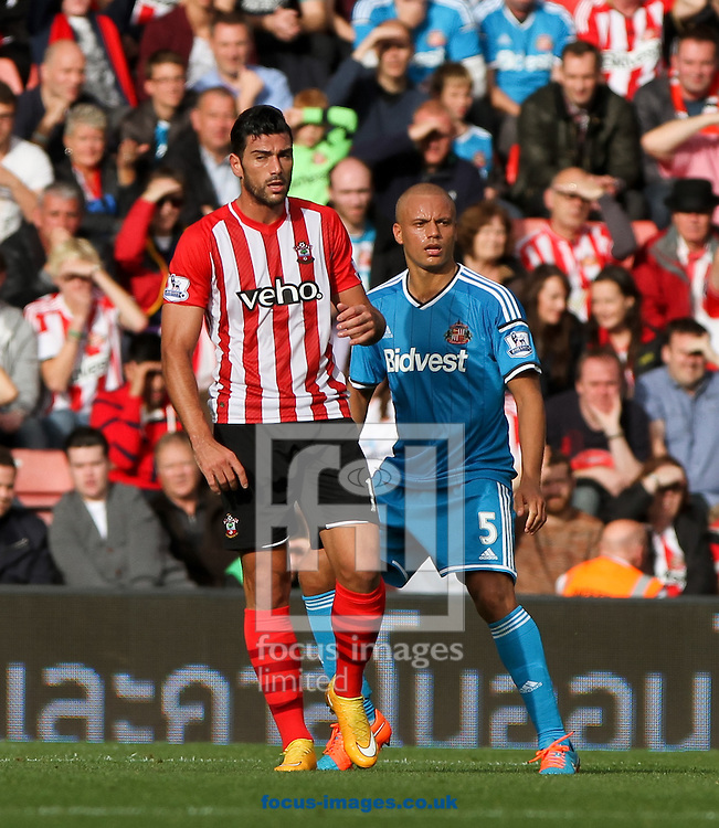 Graziano Pell&egrave; (left) of Southampton and Wes Brown (right) of Sunderland during the Barclays Premier League match at the St Mary's Stadium, Southampton<br /> Picture by Tom Smith/Focus Images Ltd 07545141164<br /> 18/10/2014