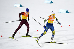 PYEONGCHANG, Feb. 17, 2018  Ebba Andersson of Sweden (R) and Olympic athlete from Russia Anastasia Sedova compete during ladies 4x5km relay of cross-country skiing at the 2018 PyeongChang Winter Olympic Games at Alpensia Cross-Country Centre, PyeongChang, South Korea, Feb. 17, 2018. Team Sweden claimed the second place in a time of 51:26.3 while Olympic athletes from Russia claimed the third in a time of 52:07.6. (Credit Image: © Ju Huanzong/Xinhua via ZUMA Wire)