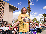 14 FEBRUARY 2012 - PHOENIX, AZ:    SHARON BRANDT, from Phoenix, dances during Wayne Newton's free concert in Phoenix Tuesday. Newton, who is originally from Phoenix, performed in front of the state capitol for about an hour Tuesday afternoon at the Arizona centennial. The state of Arizona marked 100 years of statehood with a free party in front of the capitol.    PHOTO BY JACK KURTZ