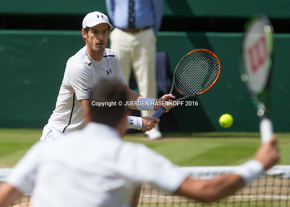 ANDY MURRAY (GBR) am Netz, Milos Raonic unscharf im Vordergrund, Herren Endspiel, Finale <br /> <br /> Tennis - Wimbledon 2016 - Grand Slam ITF / ATP / WTA -  AELTC - London -  - Great Britain  - 10 July 2016.