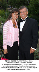 TONY & DEBBIE BLACKBURN at a dinner in London on 17th June 2004.  PWI 65