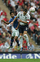 Photo: Lee Earle.<br /> England v Israel. UEFA European Championships Qualifying. 08/09/2007.England's John Terry (R) battles with Barak Itzhaki.