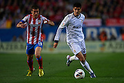MADRID, SPAIN - APRIL 27: (R) Alvaro Morata of Real Madrid CF  is followed by (L) Gabi Fernandez of Club Atletico de Madrid during the Liga BBVA between Club Atletico de Madrid and Real Madrid CF at the Vicente Calderon stadium on April 27, 2013 in Madrid, Spain. (Photo by Aitor Alcalde Colomer).
