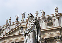 Statue of Saint Paul with façade of St Peters Basilica Berninis Square Vatican City Rome Italy