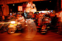 Nite life plays a big part as Harley davidson riders and admirers enjoy the downtown nite life Thursday Aug. 28, 2003 Milwaukee. Thousands of Harley Davidson bikers from all over the world came to Wisconsin to help celebrate Harley Davidson 100th anniversary.   photo by Darren Hauck