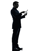 one  business man touchscreen digital tablet in silhouette on white background