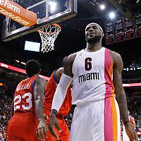21 January 2012: Miami Heat small forward LeBron James (6) reacts after being fouled by Philadelphia Sixers point guard Lou Williams (23) and Philadelphia Sixers center Tony Battie (4) during the Miami Heat 113-92 victory over the Philadelphia Sixers at the AmericanAirlines Arena, Miami, Florida, USA.