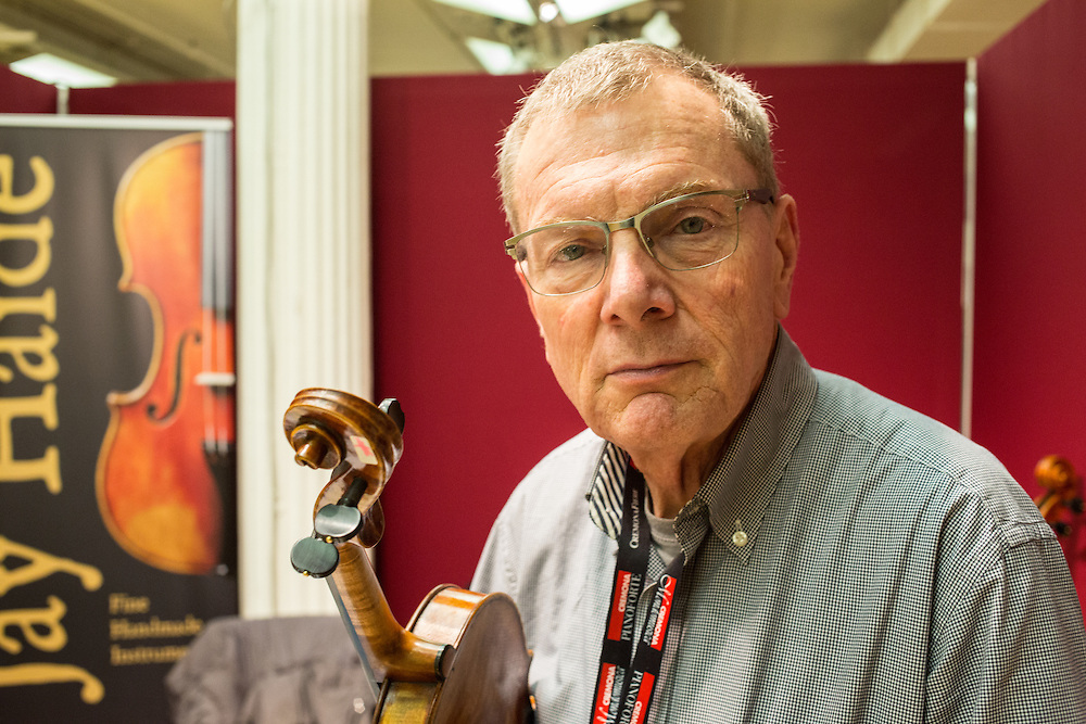 Jay Haide, a dealer in fine violins, in his booth.