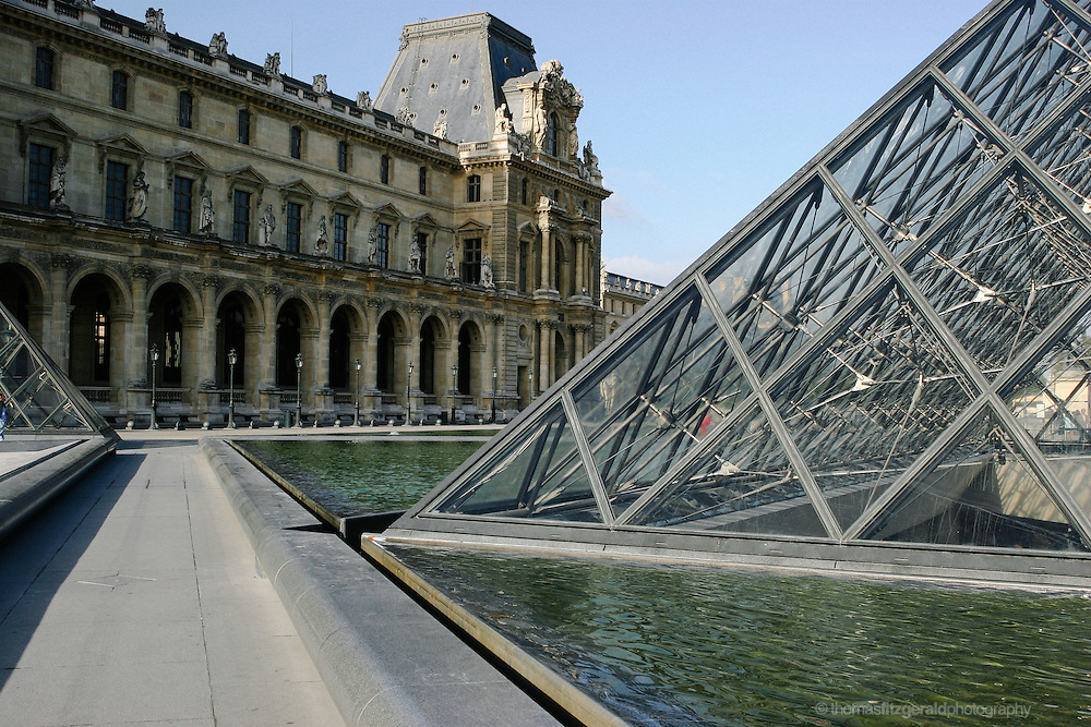 Pyramid and Fountain at the Louvre, Paris France. Image contains Grain. Editorial Only