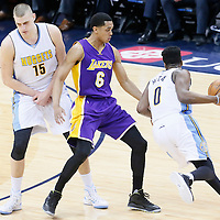 02 March 2016: Denver Nuggets guard Emmanuel Mudiay (0) drives past Los Angeles Lakers guard Jordan Clarkson (6) on a screen set by Denver Nuggets center Nikola Jokic (15) during the Denver Nuggets 117-107 victory over the Los Angeles Lakers, at the Pepsi Center, Denver, Colorado, USA.
