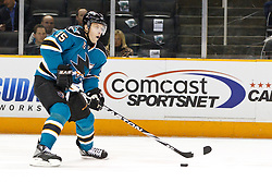 February 1, 2011; San Jose, CA, USA; San Jose Sharks right wing Dany Heatley (15) skates with the puck against the Phoenix Coyotes during the first period at HP Pavilion. Mandatory Credit: Jason O. Watson / US PRESSWIRE