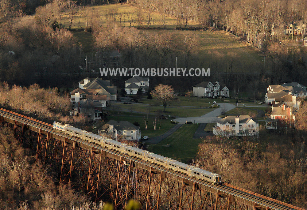 Salisbury Mills, New York - A Metro North passenger train crosses the Moodna Viaduct railroad trestle in a view from Schunnemunk Mountain onJan. 2, 2012.