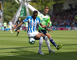 Adama Diakhaby of Huddersfield Town (L) and Joe Bennett of Cardiff City in action - Mandatory by-line: Jack Phillips/JMP - 25/08/2018 - FOOTBALL - The John Smith's Stadium - Huddersfield, England - Huddersfield Town v Cardiff City - English Premier League