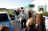 As Millennium Reign Energy's chief science officer Dave Erbaugh looks on, CEO Chris McWhinney shows how the hydrogen gets from the fueling station to the GM fuel cell car at the Dull Family Homestead, which has a private fueling station made by Millennium Reign Energy LLC, Saturday, October 15, 2011.