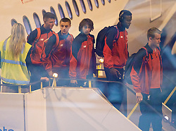 ADELAIDE, AUSTRALIA - Saturday, July 18, 2015: Liverpool's Joe Maguire, Jordan Rossiter, Lazar Markovic and Divock Origi,  step off the plane as the squad arrive at Adelaide Airport ahead of a preseason friendly match against Adelaide United on day six of the club's preseason tour. (Pic by David Rawcliffe/Propaganda)