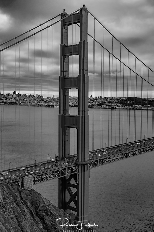 The north tower as seen from Battery Spencer hillside in San Francisco.  The cloudy sky really works in monochrome.  When printed on silver metallic photo paper the depth and drama on the entire frame literally shine.