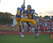 Oxford High's Zach Cousar (16) makes a touchdown catch and celebrates with Oxford High's D.K. Metcalf (14) vs. Jackson Prep in Oxford, Miss. on Friday, August 23, 2013. Oxford won 32-20.