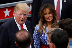 U.S. President Donald Trump and First Lady Melania Trump greet guests at a picnic for military families in Washington, D.C., U.S., on Wednesday, July 4, 2018. Dozens of retired military and national security officers joined the NAACP and the American Medical Association in urging a federal appeals court to uphold a court order blocking Trump's ban on transgender people serving in the military. Photographer: Yuri Gripas/Bloomberg
