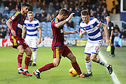 Ipswich Town defender Luke Chambers (4) tackling Queens Park Rangers striker Jamie Mackie (12) during the EFL Sky Bet Championship match between Queens Park Rangers and Ipswich Town at the Loftus Road Stadium, London, England on 2 January 2017. Photo by Matthew Redman.