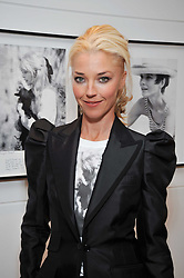 TAMARA BECKWITH at a private view of photographs by Marina Cicogna from her book Scritti e Scatti held at the Little Black Gallery, 3A Park Walk London SW10 on 16th October 2009.