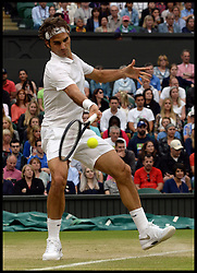 Image ©Licensed to i-Images Picture Agency. 28/06/2014. Wimbledon, London, United Kingdom. Rodger Federer V Santiago Giraldo on centre court on Day 6 of the Wimbledon Championships. Picture by Andrew Parsons / i-Images