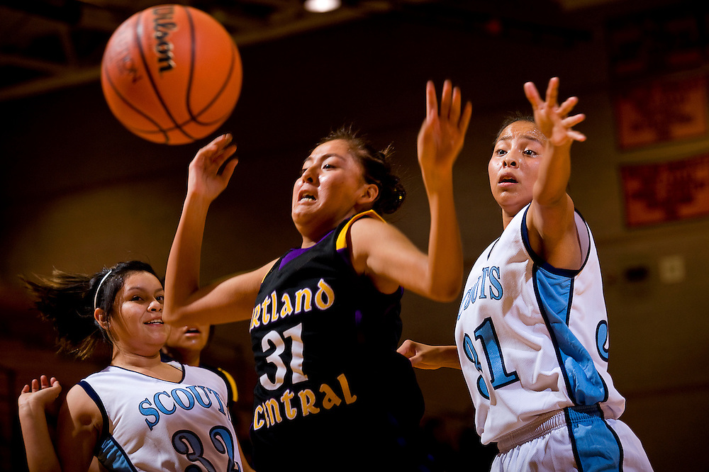 120210    Brian Leddy.Window Rock Lady Scout Arianne Sheka (31) and Kirtland Central Lady Bronco Karley Dodge (31) lose control of the ball during Thursday's Gallup Invitational tournament at Gallup High School. .