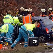 Dodelijk ongeval Randweg Huizen, .politie, beknelling, verkeer, brandweer, ambulance, trauma,
