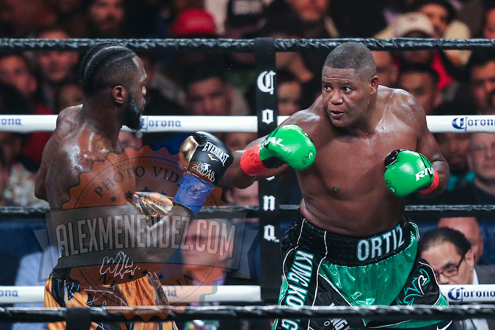 Deontay Wilder (L) fights against Luis Ortiz during the WBC Heavyweight Championship boxing match at Barclays Center on Saturday, March 3, 2018 in Brooklyn, New York. Wilder would win the bout by knockout in the tenth round to retain the title and move to 40-0. (Alex Menendez via AP)