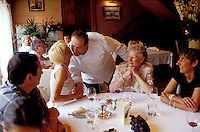 The Chef Joël Boilleaut greeting guests in his restaurant Hostellerie du Nord, in Auvers-sur-Oise, near Paris - © Owen Franken..........