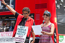 London, UK. 29 July, 2019. May McKeith reads a list of demands outside the Home Office during a protest by activists from Reclaim the Power, All African Women's Group, Docs Not Cops, Lesbians and Gays Support the Migrants and other groups to demand an end to the Government's 'hostile environment' policies.