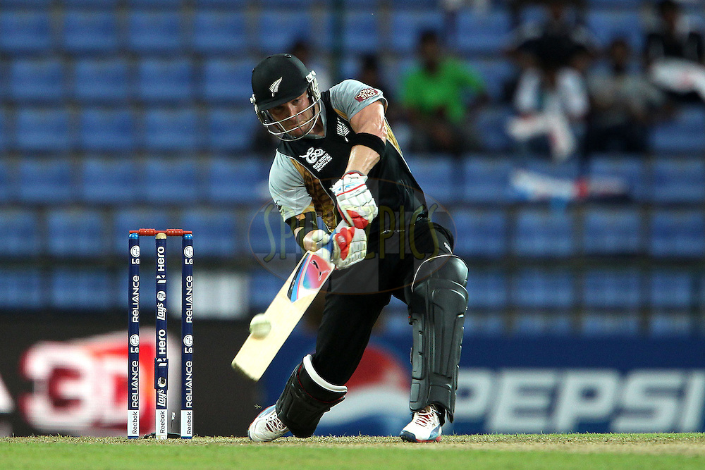 Brendon McCullum its over the top for a six during the ICC World Twenty20 Pool match between New Zealand and Bangladesh held at the  Pallekele Stadium in Kandy, Sri Lanka on the 21st September 2012..Photo byRon Gaunt/SPORTZPICS/PHOTOSPORT
