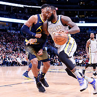07 March 2018: Cleveland Cavaliers forward LeBron James (23) drives past Denver Nuggets guard Gary Harris (14) during the Cleveland Cavaliers 113-108 victory over the Denver Nuggets, at the Pepsi Center, Denver, Colorado, USA.