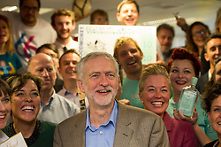 © Licensed to London News Pictures. 26/09/2015. Brighton, UK. Leader of the Labour Party JEREMY CORBYN poses for a photograph with your entrepreneurs while visiting Entrepreneurial Spark in Brighton, a group that promotes entrepreneuring. The visit takes place on the eve of the Labour Party conference, which is being held in Brighton  Photo credit: Ben Cawthra/LNP