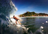 Surfing tropical waves on the Krui coastline, Sumatra, Indonesia