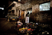 """Young people seek items from the garbage to resale. Lahore, Pakistan, on sunday, November 30 2008.....""""Pakistan is one of the countries hardest hits by the narcotics abuse into the world, during the last years it is facing a dramatic crisis as it regards the heroin consumption. The Unodc (United Nations Office on Drugs and Crime) has reported a conspicuous decline in heroin production in Southeast Asia, while damage to a big expansion in Southwest Asia. Pakistan falls under the Golden Crescent, which is one of the two major illicit opium producing centres in Asia, situated in the mountain area at the borderline between Iran, Afghanistan and Pakistan itself. .During the last 20 years drug trafficking is flourishing in the Country. It is the key transit point for Afghan drugs, including heroin, opium, morphine, and hashish, bound for Western countries, the Arab states of the Persian Gulf and Africa..Hashish and heroin seem to be the preferred drugs prevalence among males in the age bracket of 15-45 years, women comprise only 3%. More then 5% of whole country's population (constituted by around 170 milion individuals),  are regular heroin users, this abuse is conspicuous as more of an urban phenomenon. The substance is usually smoked or the smoke is inhaled, while small number of injection cases have begun to emerge in some few areas..Statistics say, drug addicts have six years of education. Heroin has been identified as the drug predominantly responsible for creating unrest in the society."""""""