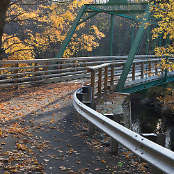 Fall foliage and a bridge over the Millers River in Erving, Massachusetts.