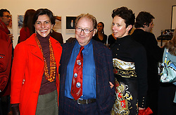 Left to right, LORD & LADY MCALPINE and VICTORIA FERNANDEZ at an exhibition of photographs by Matthew Mellon entitled Famous Feet - featuring well known people wearing shoes from Harrys of London, held at Hamiltons Gallery, Carlos Place, London on 22nd November 2004.<br />