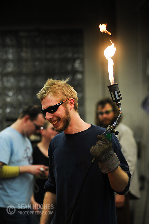 Ted Jeckering holds the flame. The Third Annual BockFest Blow at the River City Works, 532 East 12th Street, in Over-the-Rhine's Pendleton Art District took place on February 20th.
