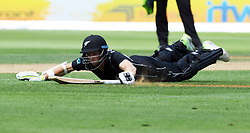 New Zealand's Mitchell Santner is run out for 1 as he slides in against Pakistan in the fifth one day International Cricket match, Basin Reserve, Wellington, New Zealand, Friday, January 19, 2018