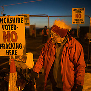 Anne Powers, 85 years old. She lives nearby but sleeps often in her car to stay close. Anti-fracking activists by the gates to Quadrilla's fracking site in New Preston Road, Lancashire. Fracking is a highly contested way of extracting gas, it is risky to extract and damaging to the environment and is banned in parts of Europe . Lancashire has in the past experienced earth quakes blamed on fracking.