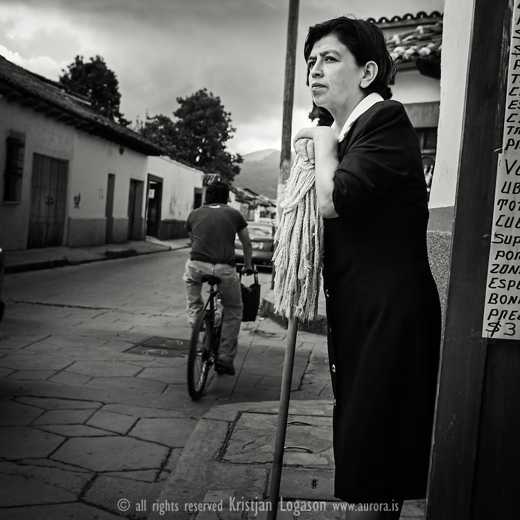 Woman with broom standing in the street of San Cristobal las Casas