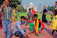 A group of youngsters belonging to sapera community, on a visit to Taj Mahal. The woman in blue though is a foreign visitor.