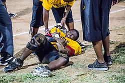 Abraham Weekes goes down hard after a tackle.  Avengerz vs. Sharks .  Lionel Roberts Stadium.  St. Thomas, VI.  15 August 2015.  © Aisha-Zakiya Boyd