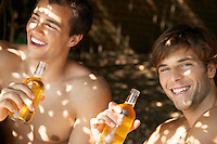 Young men drinking beer outside head and shoulders