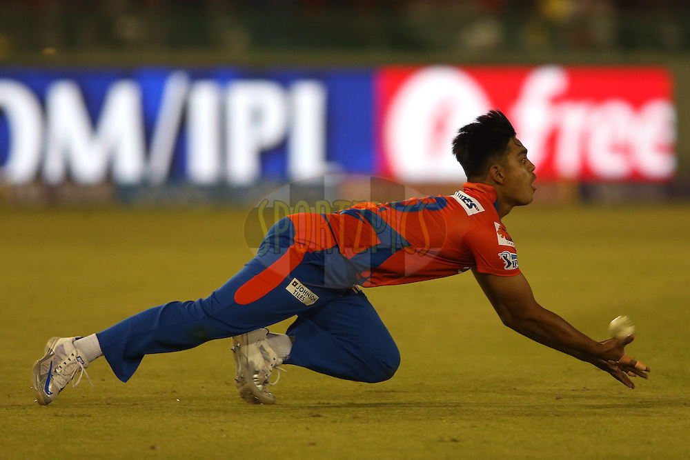Ishan Kishan of Gujarat Lions dives while attempting to take a catch during match 3 of the Vivo Indian Premier League (IPL) 2016 between the Kings XI Punjab and the Gujarat Lions held at the IS Bindra Stadium, Mohali, India on the 11th April 2016<br /> <br /> Photo by Shaun Roy/ IPL/ SPORTZPICS